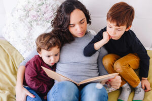 Raise a Book Lover How to Read with Your Child at Every Age_Mom and two kids reading